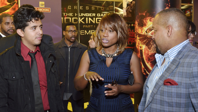 """Sharon Tomlinson, CEO and executive producer for Studio 11 Films, center, director Avery O. Williams, right, and production assistant Austreberto Hernandez are shown before a screening of """"Tw ..."""