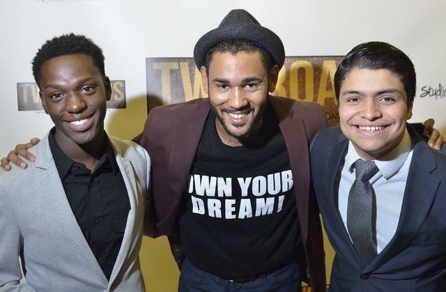 """Cameron Miller, a producer at Studio 11 Films, center, is shown with actors Jamari Edwards, left, and Jorge Corral before a screening of """"Two Roads"""" at the Brenden Theater at the Palms hotel-casin ..."""