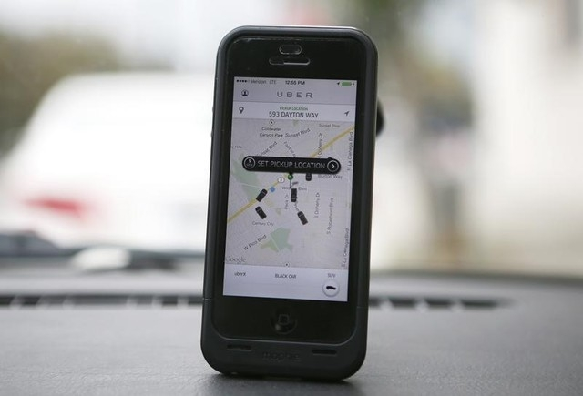 An Uber app is seen on an iPhone in Beverly Hills, California, Dec. 19, 2013. (Lucy Nicholson/Reuters file)