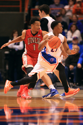 Jan 13, 2015; Boise, ID, USA; Boise State Broncos guard Montigo Alford (21) works the ball during second  half action at Taco Bell Arena against the UNLV Rebels. Boise State defeated UNLV 82-73 in ...