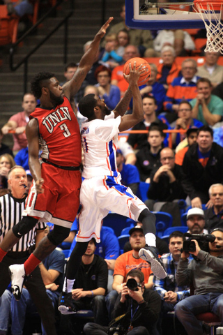 Jan 13, 2015; Boise, ID, USA; Boise State Broncos guard Mikey Thompson (1) drives to the basket past UNLV Rebels guard Jordan Cornish (3) during second half action at Taco Bell Arena. Boise State  ...