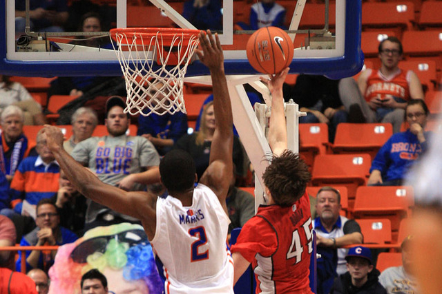 Jan 13, 2015; Boise, ID, USA; Boise State Broncos guard Derrick Marks (2) attempts to block a lay up by UNLV Rebels guard Cody Doolin (45) during first half action at Taco Bell Arena. Mandatory Cr ...