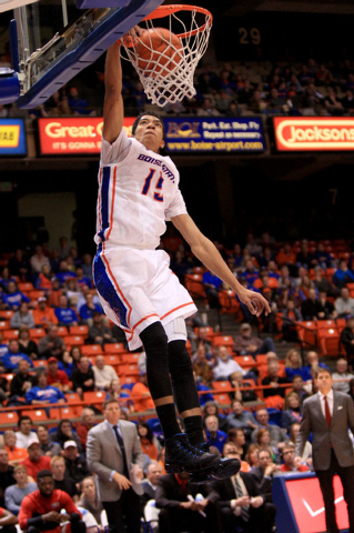 Jan 13, 2015; Boise, ID, USA; Boise State Broncos guard Chandler Hutchison (15) dunks to conclude a fast break during first half action at Taco Bell Arena against the UNLV Rebels. Mandatory Credit ...