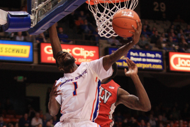 Jan 13, 2015; Boise, ID, USA; Boise State Broncos guard Mikey Thompson (1) goes up and under against UNLV Rebels forward Dwayne Morgan (15) during first half action at Taco Bell Arena. Mandatory C ...