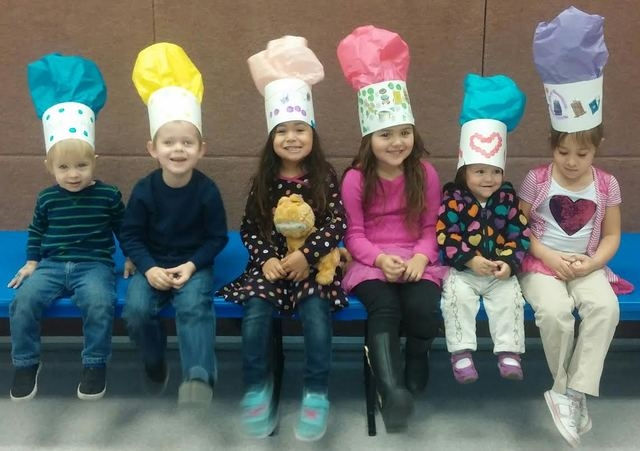 Children model chefs' hats while participating in the University of Nevada Cooperative Extension's family literacy program in November 2013 at the Whitney Ranch Recreation Center, 1575 Galleria Dr ...