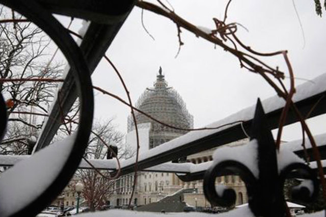 The U.S. Capitol building is seen through a snow-covered trellis at the start of the 114th Congress on the Capitol grounds in Washington, Jan. 6, 2015. An Ohio man was arrested Wednesday, Jan. 14, ...