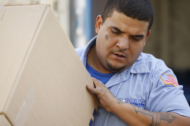 Carlos Fonseca, employee for Puliz Moving and Storage, moves boxes to a home inside the Tides community in Las Vegas Monday, Jan. 5, 2015. (Erik Verduzco/Las Vegas Review-Journal)