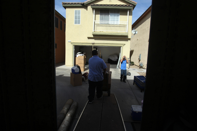 Employees with Puliz Moving and Storage move furniture into a home inside the Tides community in Las Vegas Monday, Jan. 5, 2015. (Erik Verduzco/Las Vegas Review-Journal)