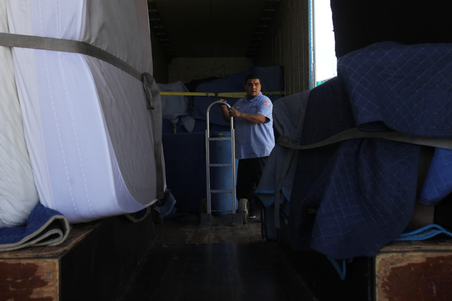 Carlos Fonseca, employee for Puliz Moving and Storage, looks for furniture to move into a home at the Tides community in Las Vegas Monday, Jan. 5, 2015. (Erik Verduzco/Las Vegas Review-Journal)