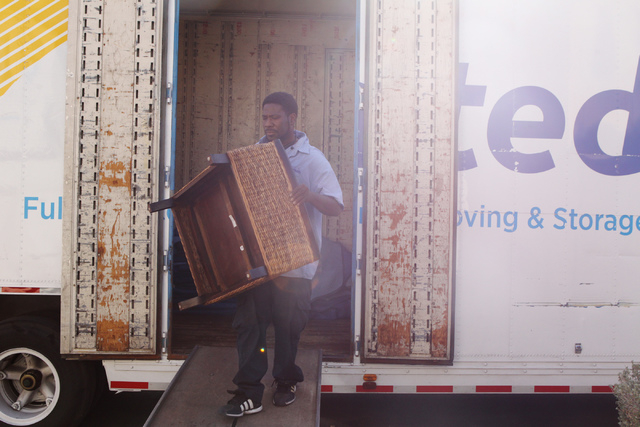 James Oliphant, employee for Puliz Moving and Storage, moves furniture to a home inside the Tides community in Las Vegas Monday, Jan. 5, 2015. (Erik Verduzco/Las Vegas Review-Journal)