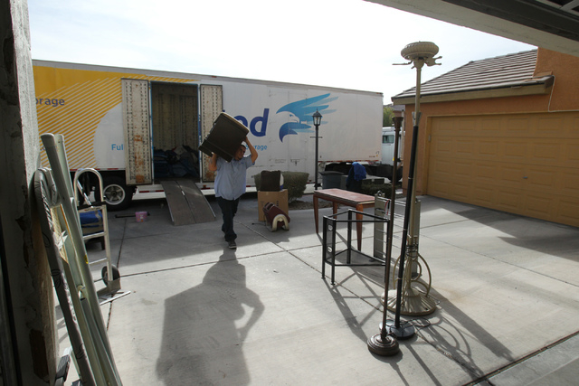 Carlos Fonseca, employee for Puliz Moving and Storage, moves furniture into a home inside the Tides community in Las Vegas Monday, Jan. 5, 2015. (Erik Verduzco/Las Vegas Review-Journal)