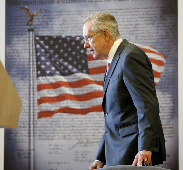 U.S. Sen. Harry Reid arrives at the dedication ceremony for the new Veterans Affairs Medical Center in North Las Vegas, Monday, Aug. 6, 2012. The billion-dollar facility is scheduled to open on Au ...