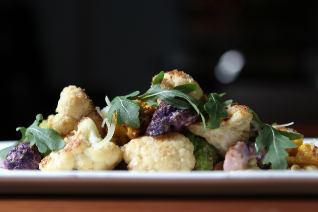 A roasted cauliflower with anchovy pesto, arugula, pine nuts and parmesan cheese is seen served at the Public House Restaurant inside the Grand Canal Shoppes at the Venetian casino-hotel Sunday, J ...