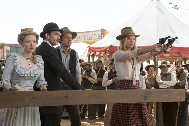 "Amanda Seyfried, left, Neil Patrick Harris, Seth MacFarlane and Charlize Theron star in ""A Million Ways to Die in the West."" (Universal Studios)"