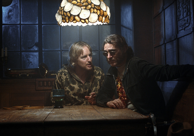 """Owen Wilson stars as Coy Harlingen and Joaquin Phoenix as Larry """"Doc"""" Sportello in Warner Bros. Pictures' and IAC Films' """"Inherent Vice,"""" a Warner Bros. Pictures release. (Courtesy)"""
