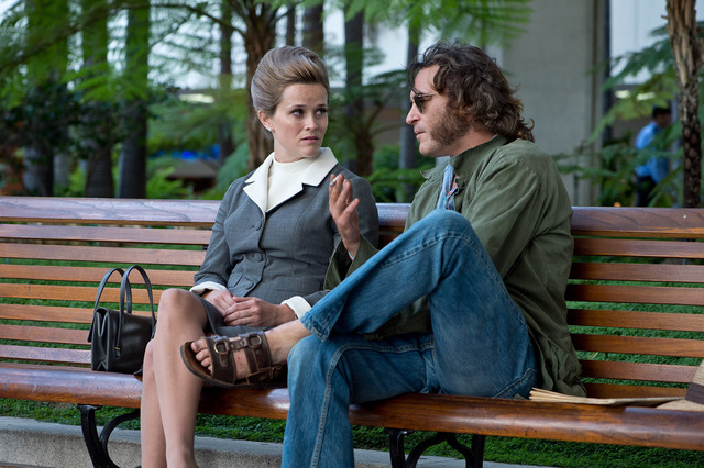 """Reese Witherspoon as Deputy D.A. Penny Kimball and Joaquin Phoenix as Larry """"Doc"""" Sportello in Warner Bros. Pictures' and IAC Films' """"Inherent Vice,"""" a Warner Bros. Pictures release. (Courtesy)"""