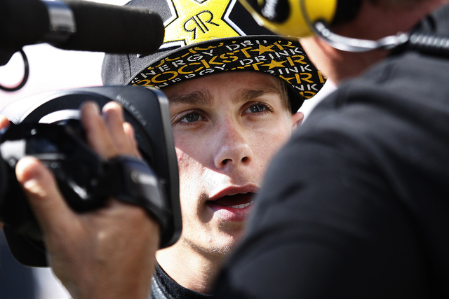 Driver Dylan Kwasniewski gets interviewed after crashing his car during practice for the Nationwide Series Boyd Gaming 300 at the Las Vegas Motor Speedway on Friday, March 7, 2014. (Jason Bean/Las ...