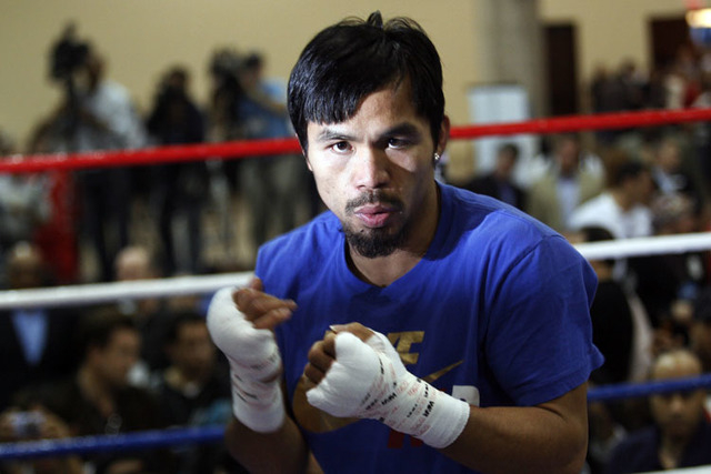 Manny Pacquiao has reportedly agreed to terms to fight Floyd Mayweather on May 2. Mayweather has not yet committed. (REUTERS/Mike Stone)