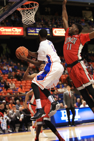 Jan 13, 2015; Boise, ID, USA; Boise State Broncos guard Mikey Thompson (1) drives under the basket past UNLV Rebels forward Goodluck Okonoboh (11) during first half action at Taco Bell Arena. Mand ...