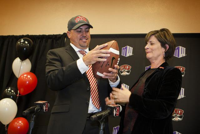 UNLV Athletics Tina Kunzer-Murphy, right, introduced Tony Sanchez as UNLV's Men's football coach, Thursday, Dec. 11, 2014. (Jeff Scheid/Las Vegas Review-Journal)