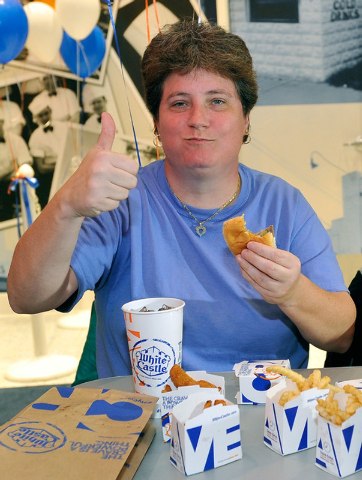 Linda Kitchel gives her approval after taking her first bite of a White Castle burger during the grand opening of White Castle's newest and only location west of the Rocky mountains in Las Vegas o ...