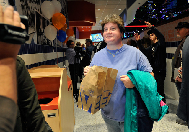 Linda Kitchel carries her bag of White Castle burgers during the grand opening of White Castle's newest and only location west of the Rocky mountains in Las Vegas on Tuesday, Jan. 27, 2015.  Kitch ...
