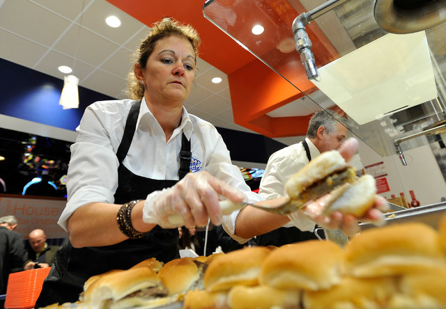 Lisa Ingram, president of White Castle, prepares slider burgers during the grand opening of the hamburger chain's newest and only location in Nevada on Tuesday, Jan. 27, 2015. (David Becker/Las Ve ...