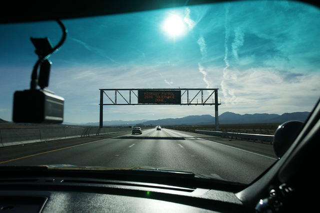 A sign warning drivers is seen through the windshield of a Nevada Highway Patrol vehicle along Interstate 15 south of Las Vegas Saturday, Jan. 11, 2014. (John Locher/Las Vegas Review-Journal)