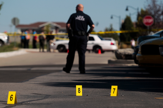 FILE - In this Sept. 10, 2014, file photo, evidence tags and shell casings lay on the ground at the scene of a shooting in Saratoga Springs, Utah. Officials in Saratoga Springs, where a young blac ...