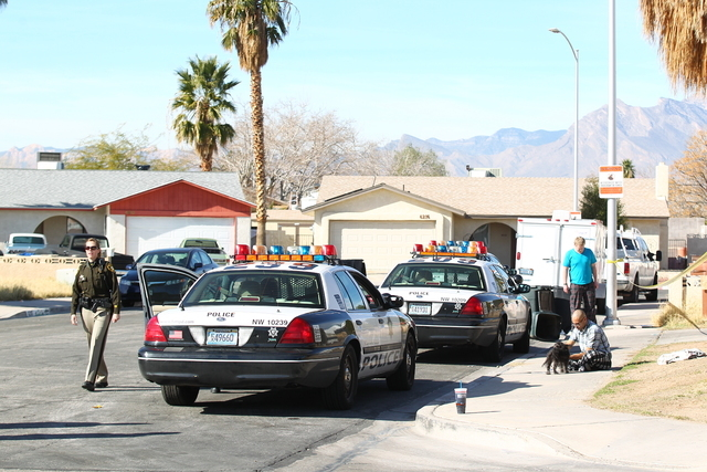 Las Vegas police respond to the 6200 block of Robin Hood Circle, near Smoke Ranch Road and Torrey Pines Drive, just before 8:30 a.m. Tuesday, Feb. 3, 2015, after receiving calls about a person bei ...