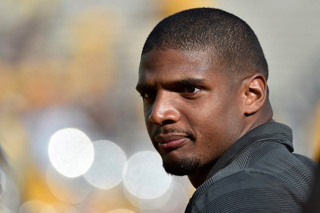 Aug 30, 2014; Columbia, MO, USA;  NFL rookie Michael Sam watches the game between the Missouri Tigers and the South Dakota State Jackrabbits during the second half at Faurot Field. (Jasen Vinlove- ...