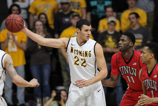 Wyoming Cowboys head forward Larry Nance Jr. (22) holds the ball against UNLV Runnin' Rebels forward Goodluck Okonoboh (11) and guard Rashad Vaughn (1) during the first half at Arena-Auditorium. T ...