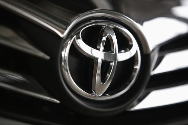 A Toyota logo is seen on a car inside a showroom at a Toyota dealership in Warsaw April 11, 2014. (REUTERS/Kacper Pempel)