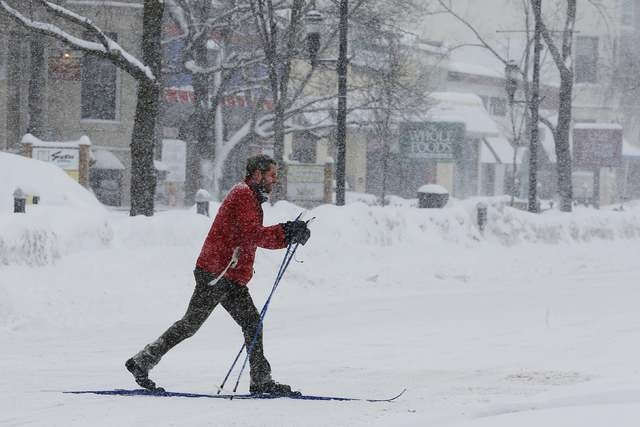 A man skis across an intersection during a winter snow storm in Brookline, Massachusetts February 9, 2015. (REUTERS/Brian Snyder)