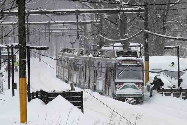 An MBTA green line subway train sits at a station during a winter snow storm in Brookline, Massachusetts February 9, 2015.  (REUTERS/Brian Snyder)