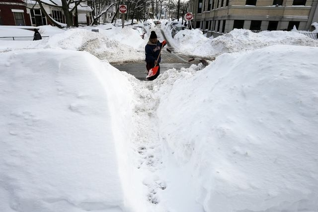 Aaron Bray, who came out to help clear snow around busy school routes at the request of the activist group Black Lives Matter Boston, shovels a sidewalk on Humboldt Ave in Boston, Massachusetts Fe ...