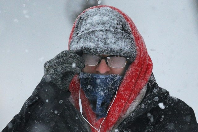 A pedestrian with his glasses fogged over walks through the snow during a winter blizzard in Cambridge, Massachusetts February 15, 2015. (REUTERS/Brian Snyder)