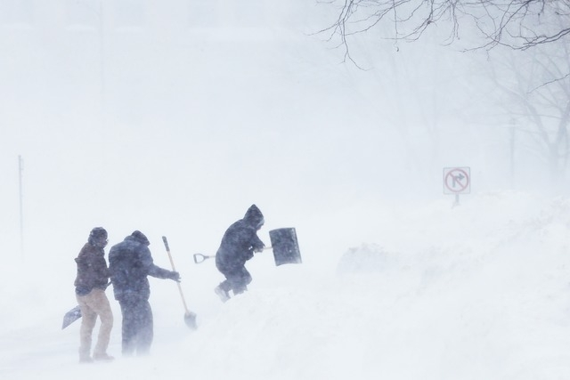 A snow shoveling crew crosses a street during a winter blizzard in Cambridge, Massachusetts February 15, 2015. (REUTERS/Brian Snyder)