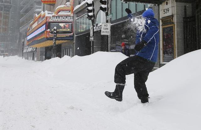 Tom McQuail is hit by a snowball thrown by his daughter during a winter blizzard in Boston, Massachusetts February 15, 2015. (REUTERS/Brian Snyder)
