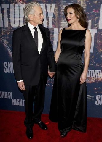 Actor Michael Douglas and wife Catherine Zeta-Jones arrive for the 40th Anniversary Saturday Night Live (SNL) broadcast in the Manhattan Borough of New York February 15, 2015. (REUTERS/Carlo Allegri )
