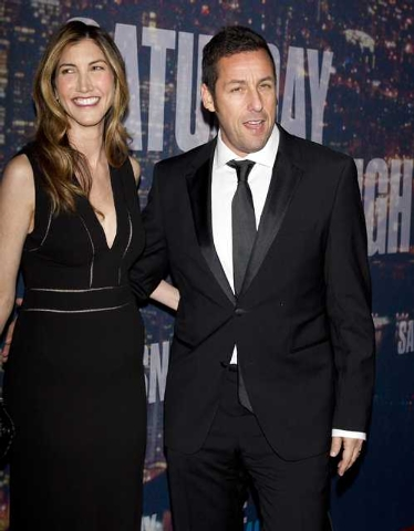 Actor Adam Sandler and wife Jackie Sandler arrive for the 40th Anniversary Saturday Night Live (SNL) broadcast in the Manhattan Borough of New York February 15, 2015. (REUTERS/Carlo Allegri)