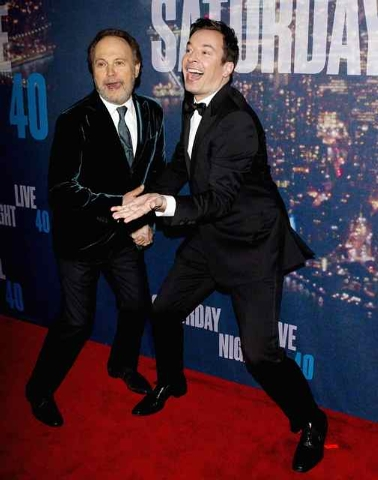 Actor Billy Crystal (L) and TV host Jimmy Fallon arrive for the 40th Anniversary Saturday Night Live (SNL) broadcast in the Manhattan borough of New York February 15, 2015. (REUTERS/Carlo Allegri)