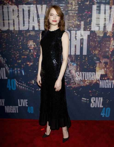 Actress Emma Stone arrives for the 40th Anniversary Saturday Night Live (SNL) broadcast in the Manhattan borough of New York, February 15, 2015. (REUTERS/Carlo Allegri)