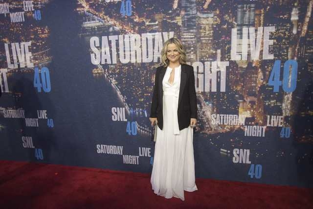 Actress Amy Poehler arrives for the 40th Anniversary Saturday Night Live (SNL) broadcast in the Manhattan borough of New York, February 15, 2015. (REUTERS/Carlo Allegri)