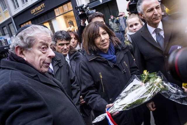 Paris Mayor Anne Hidalgo (C) visits the site, where a Danish Jew was shot dead as he stood guard at a Jewish confirmation at the weekend, in front of the synagogue in Krystalgade, Copenhagen, Febr ...