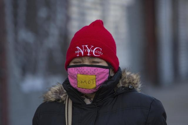 A woman walks down Delancey Street in Lower Manhattan, New York February 16, 2015. (REUTERS/Andrew Kelly)