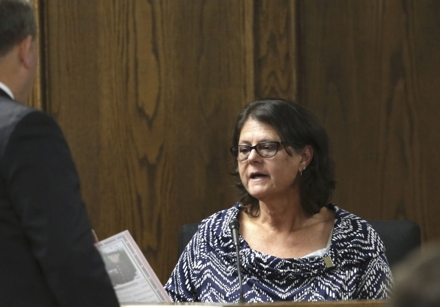 Jodi Routh, mother of former Marine Eddie Ray Routh, testifies as she looks at a photo of her son that was admitted into evidence during his capital murder trial in Stephenville, Texas, Thursday,  ...