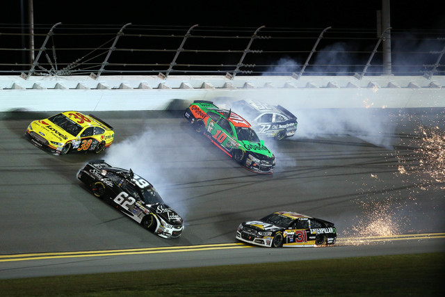 Feb 19, 2015; Daytona Beach, FL, USA; NASCAR Sprint Cup Series drivers Danica Patrick (10), Bobby Labonte (32), Ryan Newman (31) and Brian Scott (62) wreck during race two of the Budweiser Duels a ...