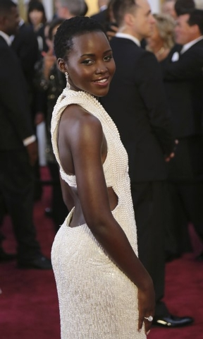 Actress Lupita Nyong'o wears a Calvin Klein gown and Chopard diamonds as she arrives at the 87th Academy Awards in Hollywood, California February 22, 2015. (REUTERS/Robert Galbraith)