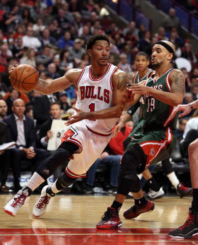 Feb 23, 2015; Chicago, IL, USA; Chicago Bulls guard Derrick Rose (1) drives around defender Milwaukee Bucks guard Jerryd Bayless (19) during the game at United Center. (Caylor Arnold-USA TODAY Sports)